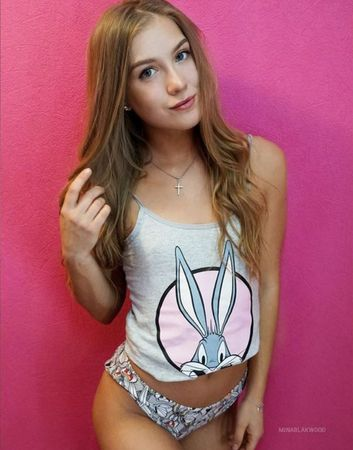 Super cute teen cam girl wearing bugs bunny top and panties smiling at the camera