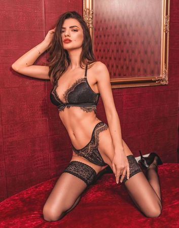 Erotic brunette cam model with a sexy gaze wearing some amazing black lingerie